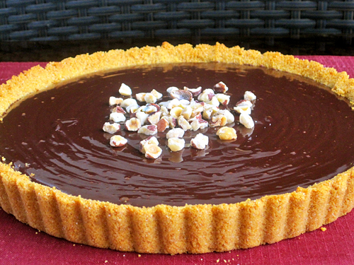 Chocolate Ganache Tart w/ Hazelnut Crumbles from The Cultural Dish