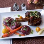 {Basque Stage} Braised Lamb Shank, Goat Cheese Beet Ravioli & Confit Root Vegetables