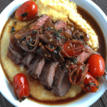 Garlic Marinated Ribeye w/ Creamy Parmesan Polenta & Blistered Tomatoes
