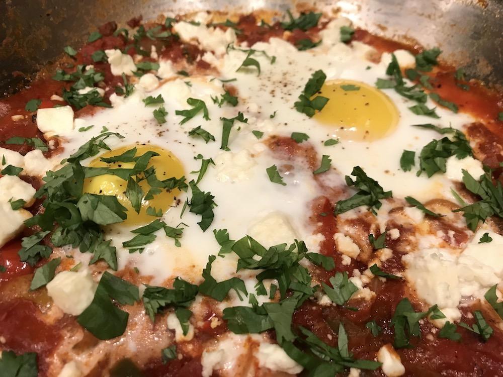 Shakshuka with feta cheese and baked eggs
