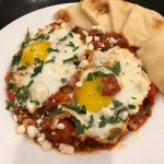 Shakshouka with Pita Bread recipe including feta cheese and baked eggs